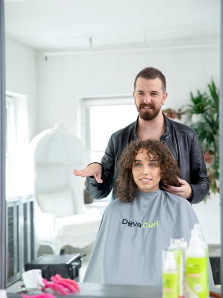 hair stylist touching curly hair