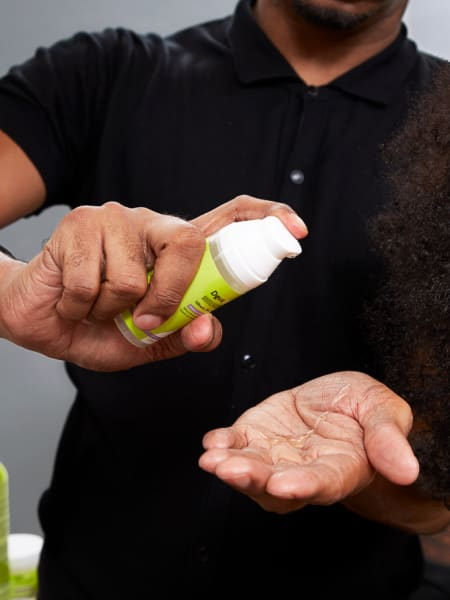 hands pump devacurl product bottle