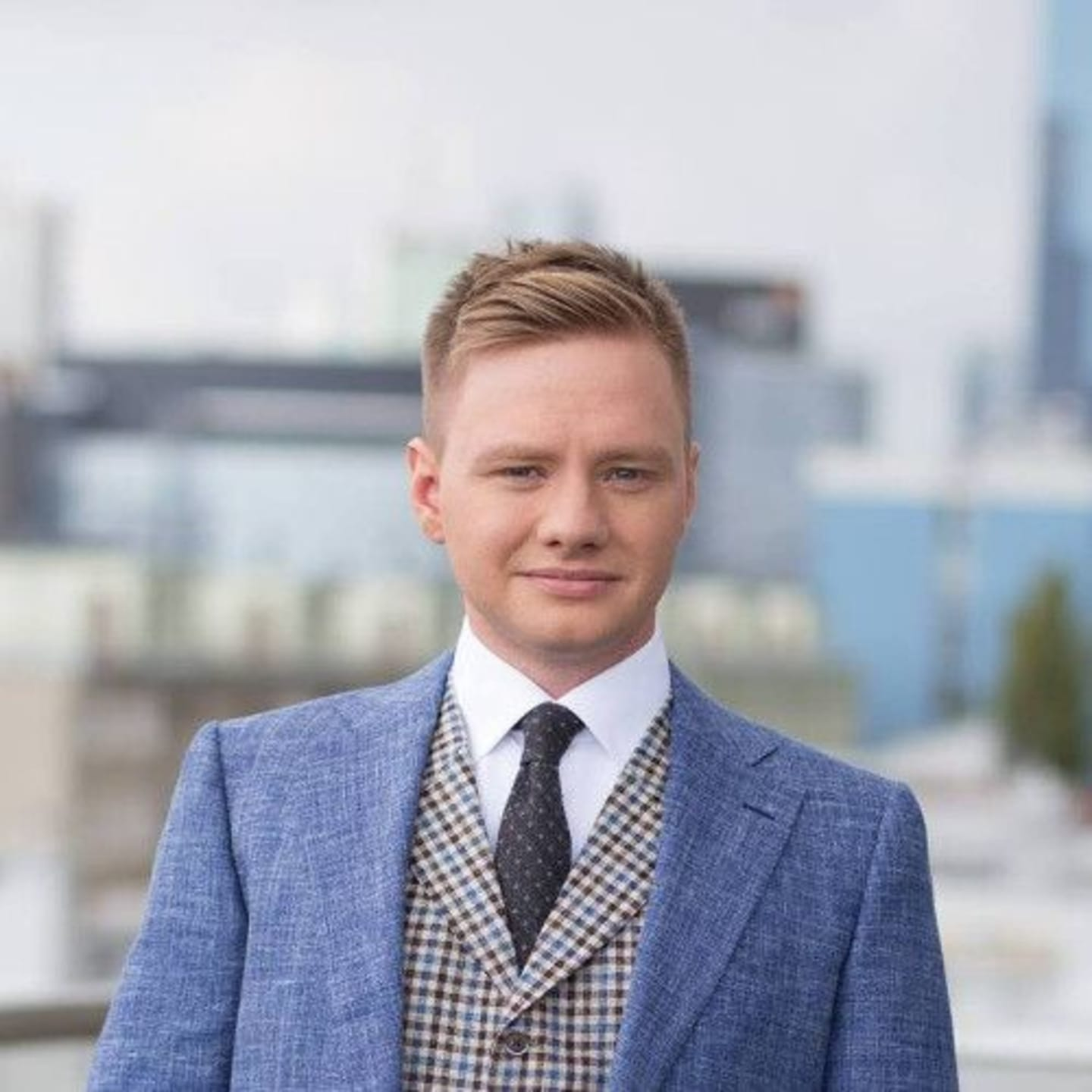 A photograph of Bartosz Baziński, the COO of SentiOne.