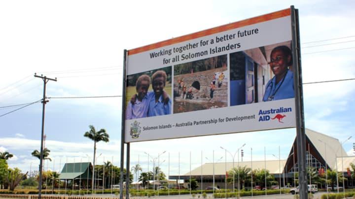 an australian aid billboard in solomon islands foreign aid budget will be cut by 37 billion australian dollars over three years