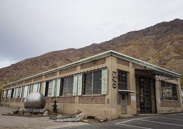 Rustica Hardware Headquarters in front of mountain