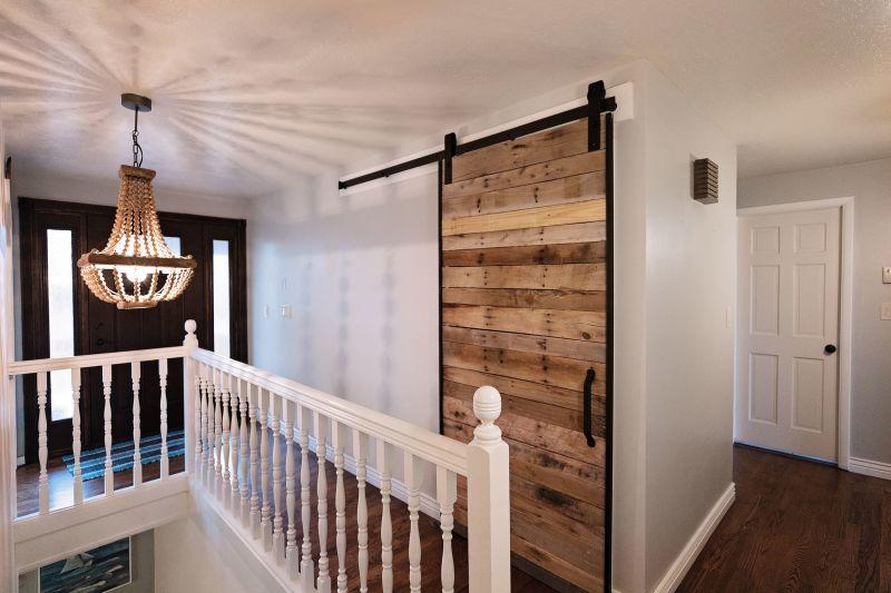 DIY Sliding Barn Door Kit installed in a hallway