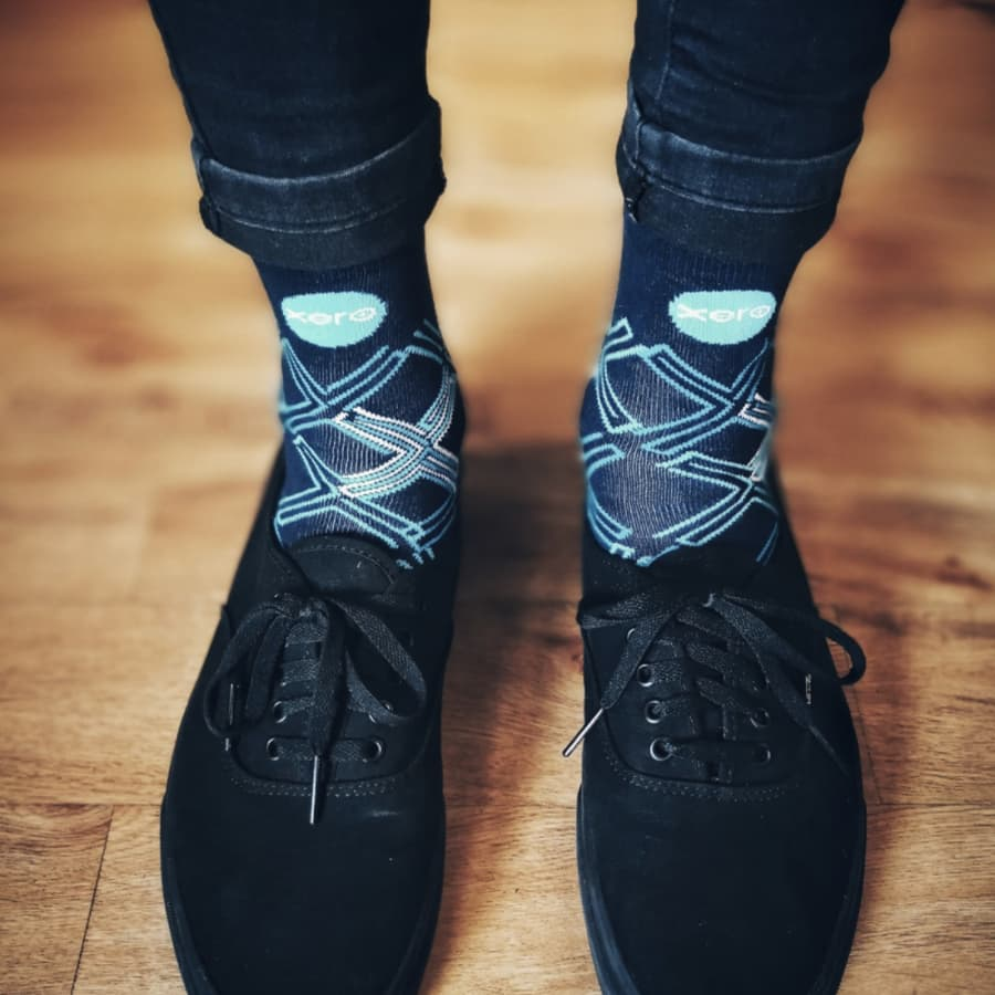 Xero socks worn with black canvas shoes