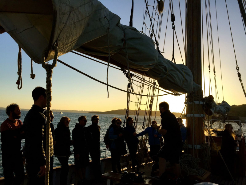team deck sailing sunset