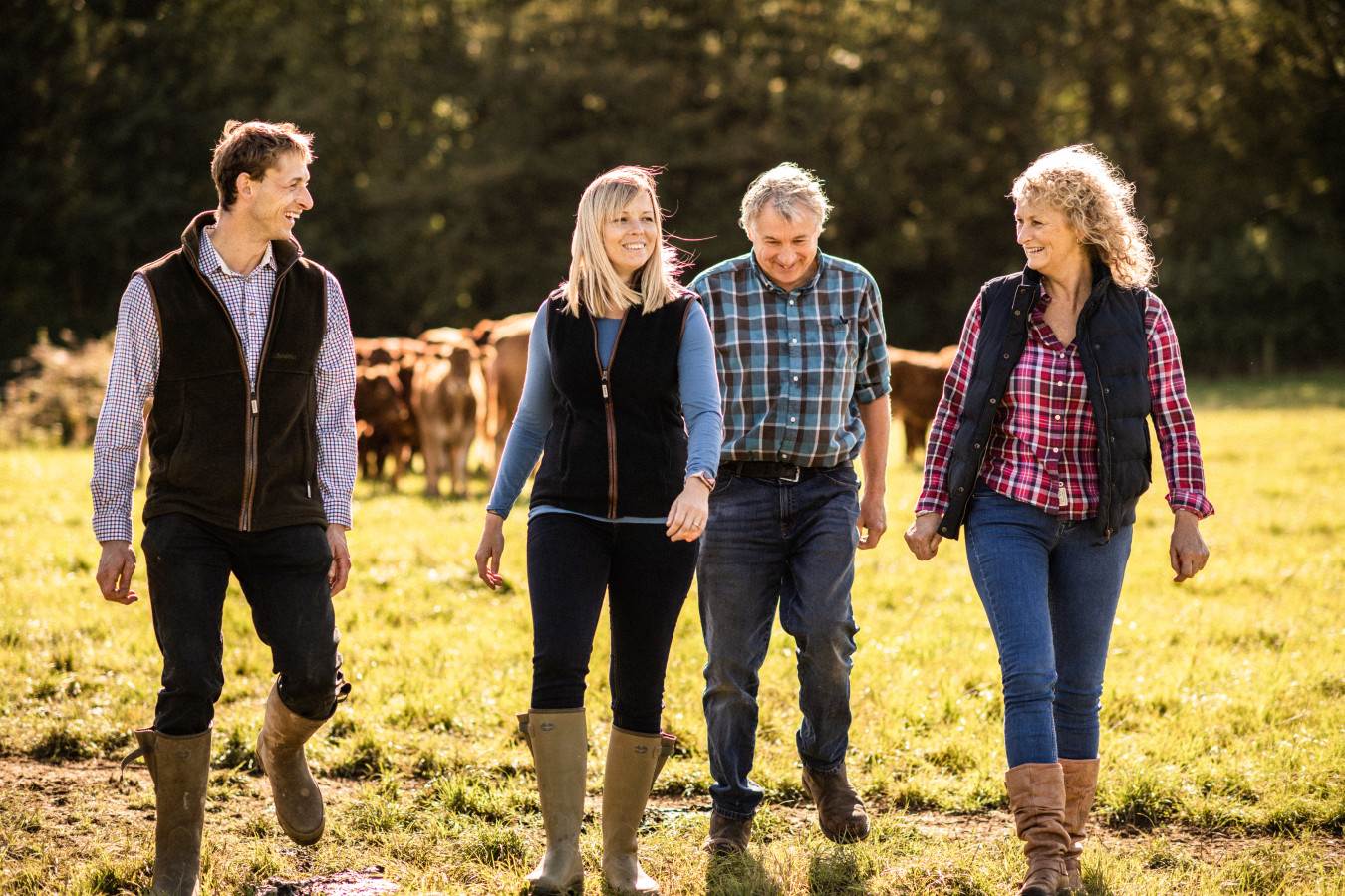 Mounce Family walking and laughing together through field on their farm