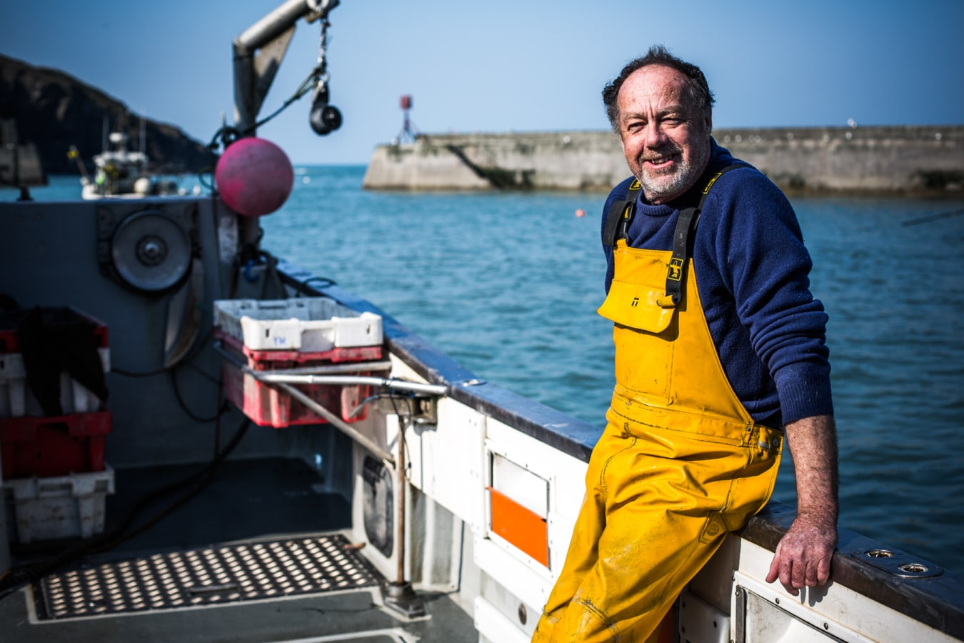 Fisherman at port issacc in cornwall fishing for fresh fish