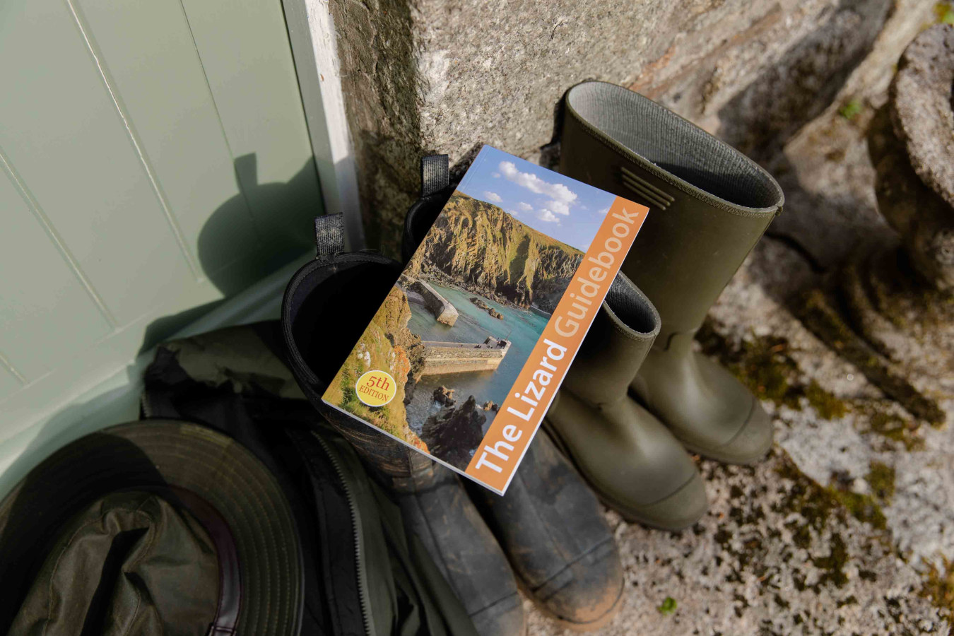 Friendly Guide Book resting on Wellngton Boots outside