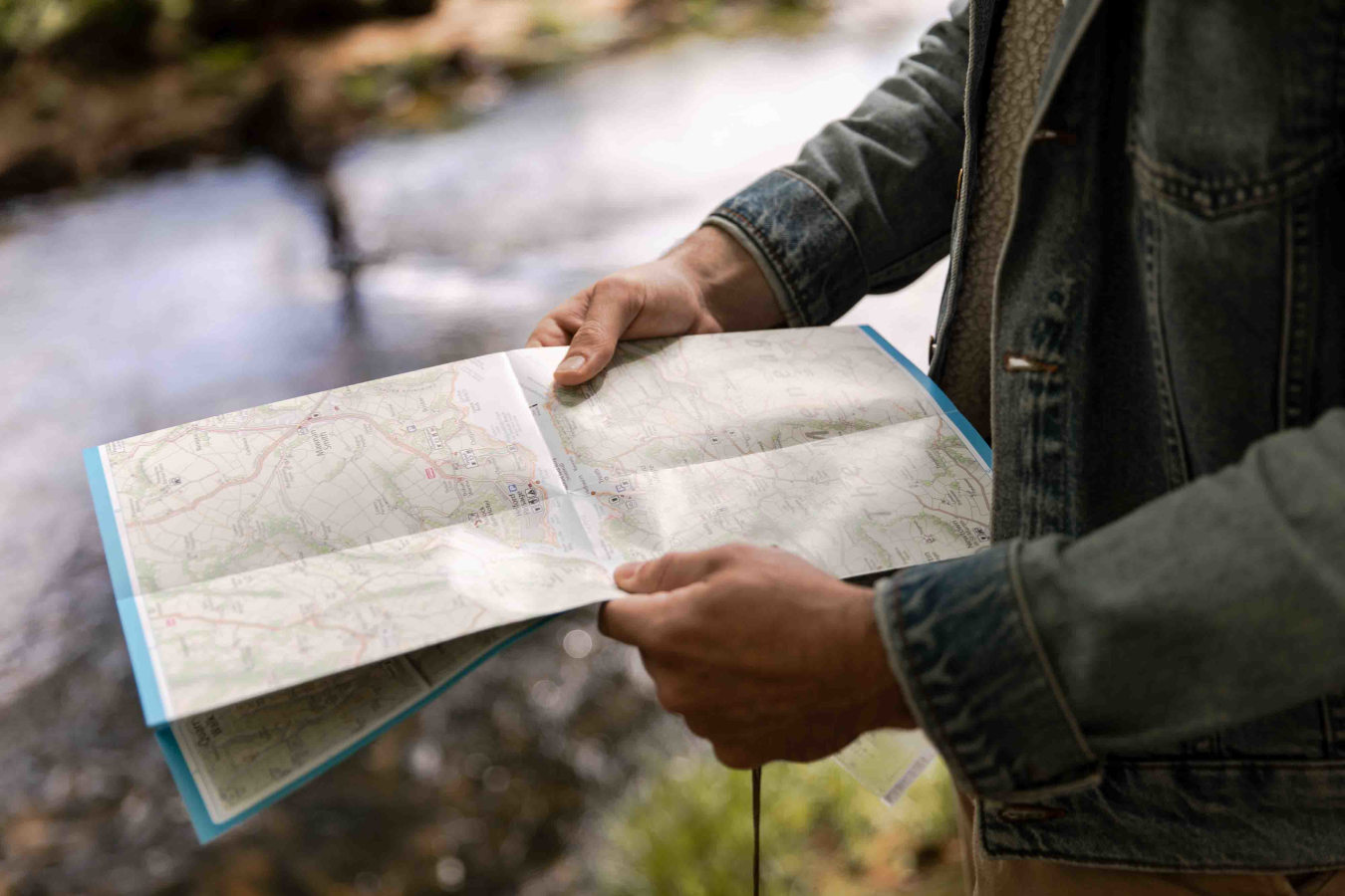 Man holding map by river