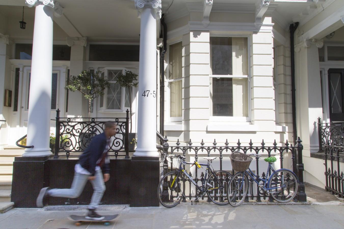 Richmond University image of a man skateboarding outside a block of flats in London