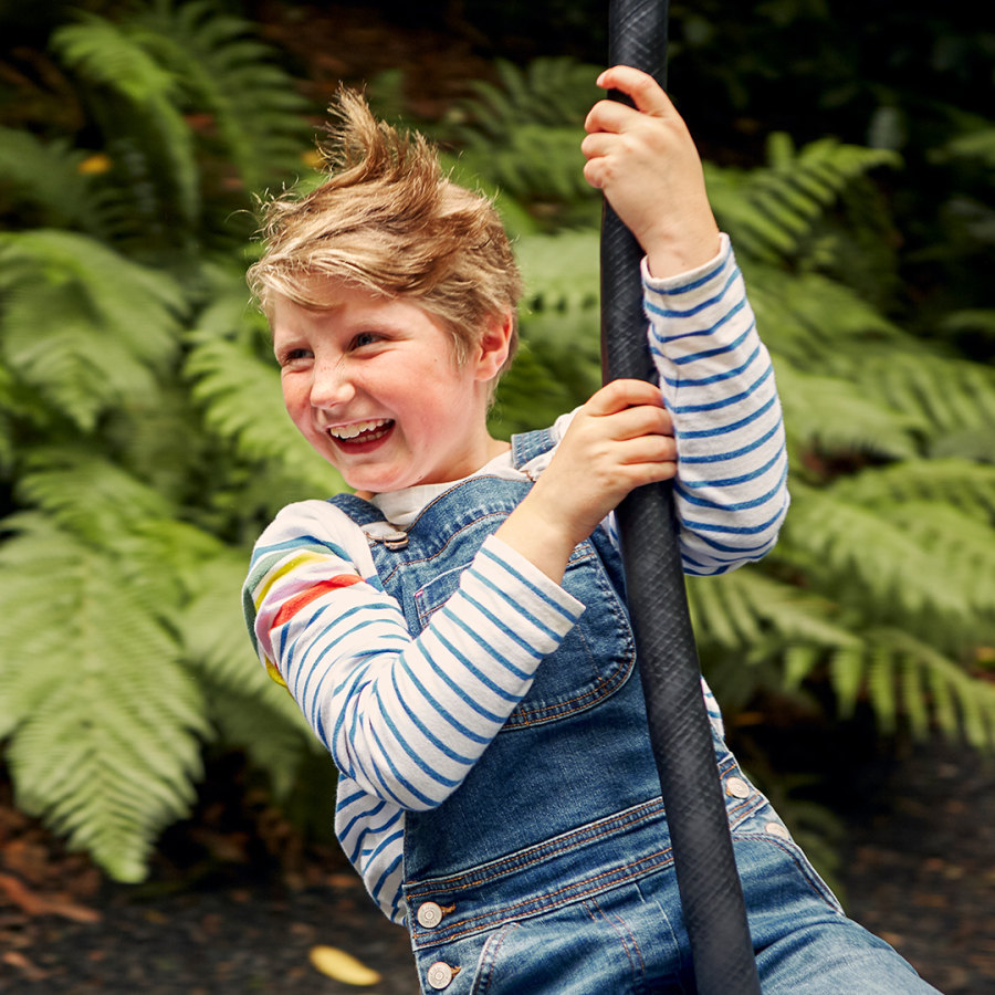 Child on a zip wire at Trebah Gardens Cornwall at square ratio