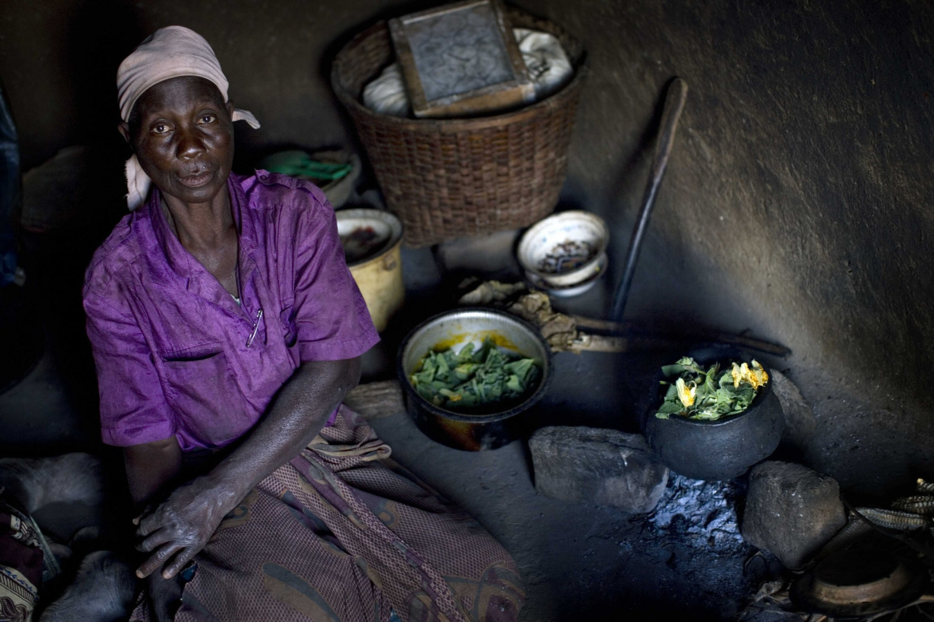 DLP image of a woman in Malawi in her house