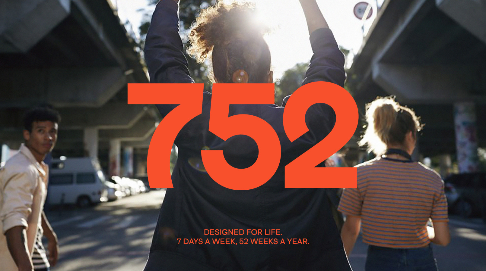 752 logo over layed on image of woman walking away with her hands in the air