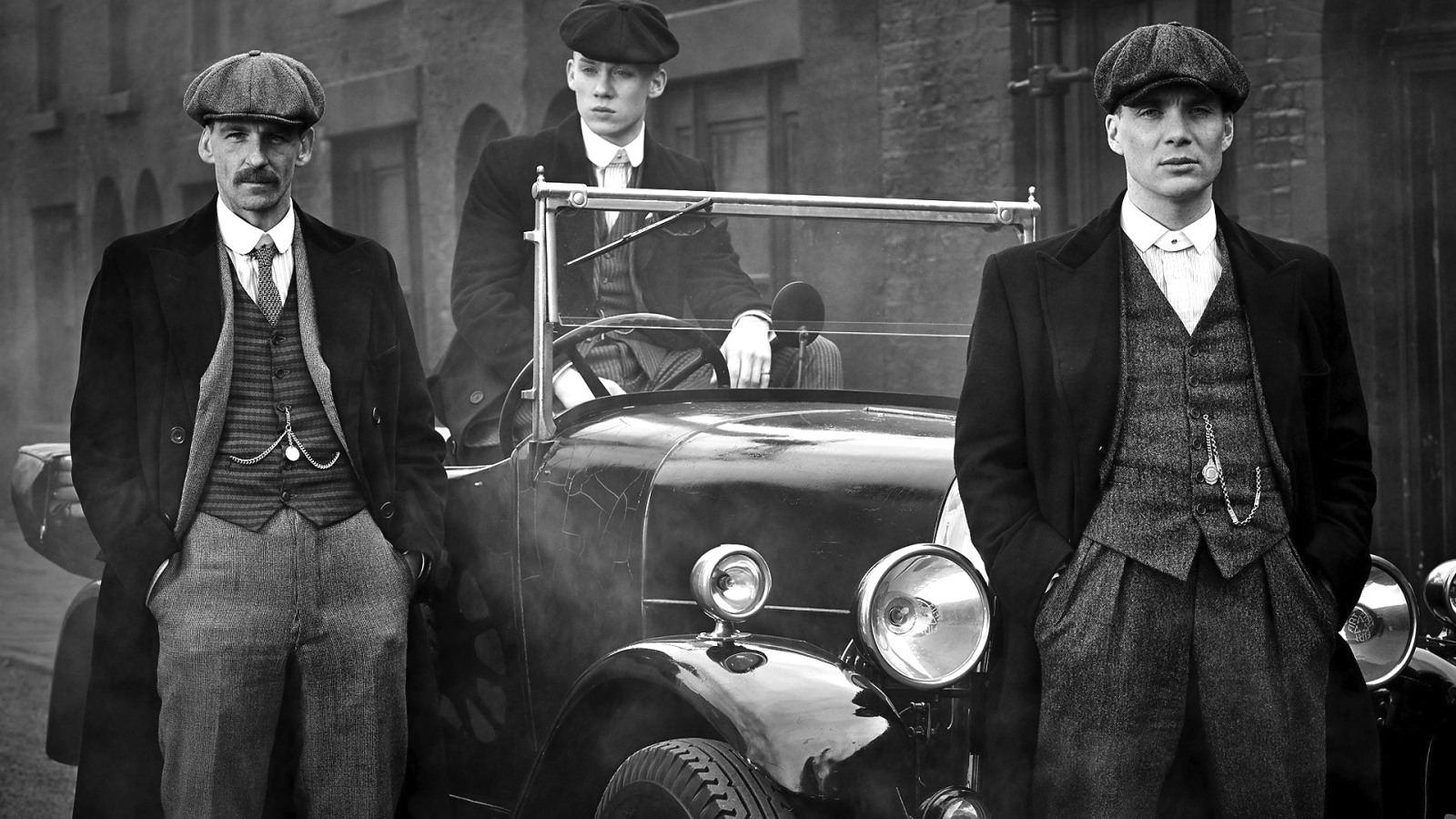 All three Peaky Blinders posing by their car