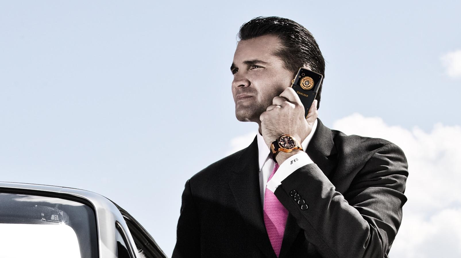 Man holding a Ulysse Nardin cell phone