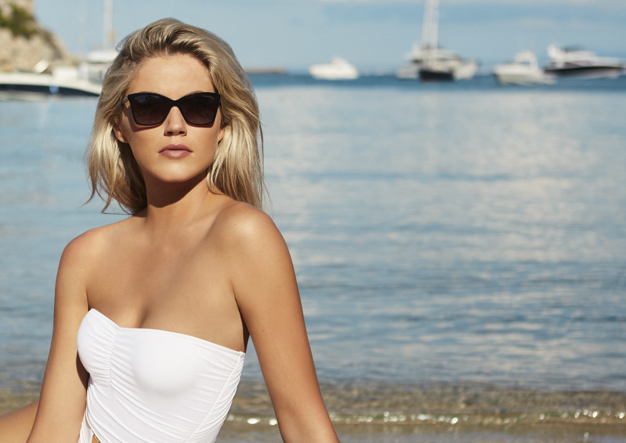 Image of model wearing Eyespace sunglasses by the sea