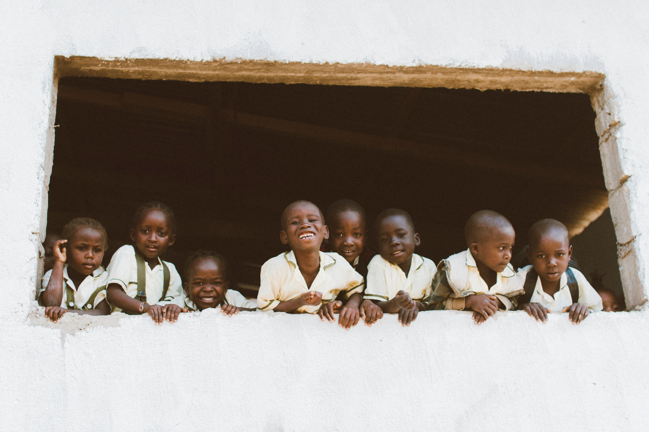 Group of children looking out of the window