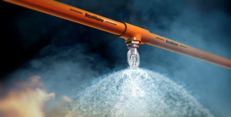 How does a fire sprinkler system function?