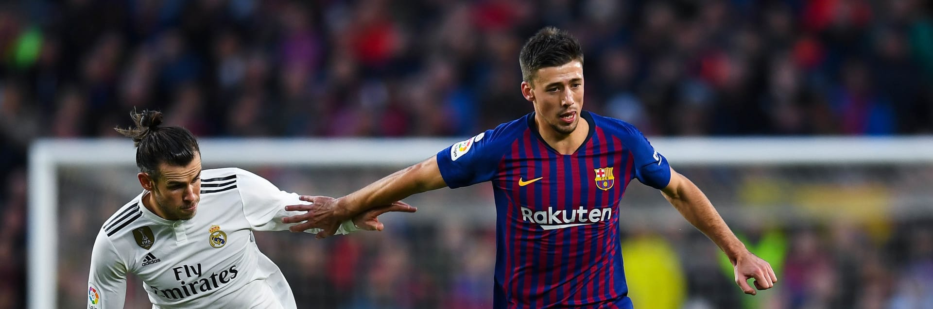 BARCELONA, SPAIN - OCTOBER 28:  Clement Lenglet of FC Barcelona competes for the ball with Gareth Bale of Real Madrid CF during the La Liga match between FC Barcelona and Real Madrid CF at Camp Nou on October 28, 2018 in Barcelona, Spain.  (Photo by David Ramos/Getty Images)