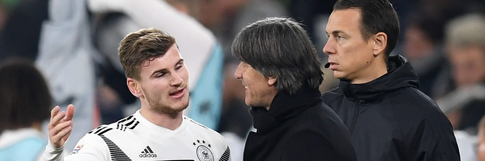 GELSENKIRCHEN, GERMANY - NOVEMBER 19:  Timo Werner of Germany speaks to Joachim Loew, Manager of Germany as he is substituted during the UEFA Nations League A group one match between Germany and Netherlands at Veltins-Arena on November 19, 2018 in Gelsenkirchen, Germany.  (Photo by Matthias Hangst/Bongarts/Getty Images)