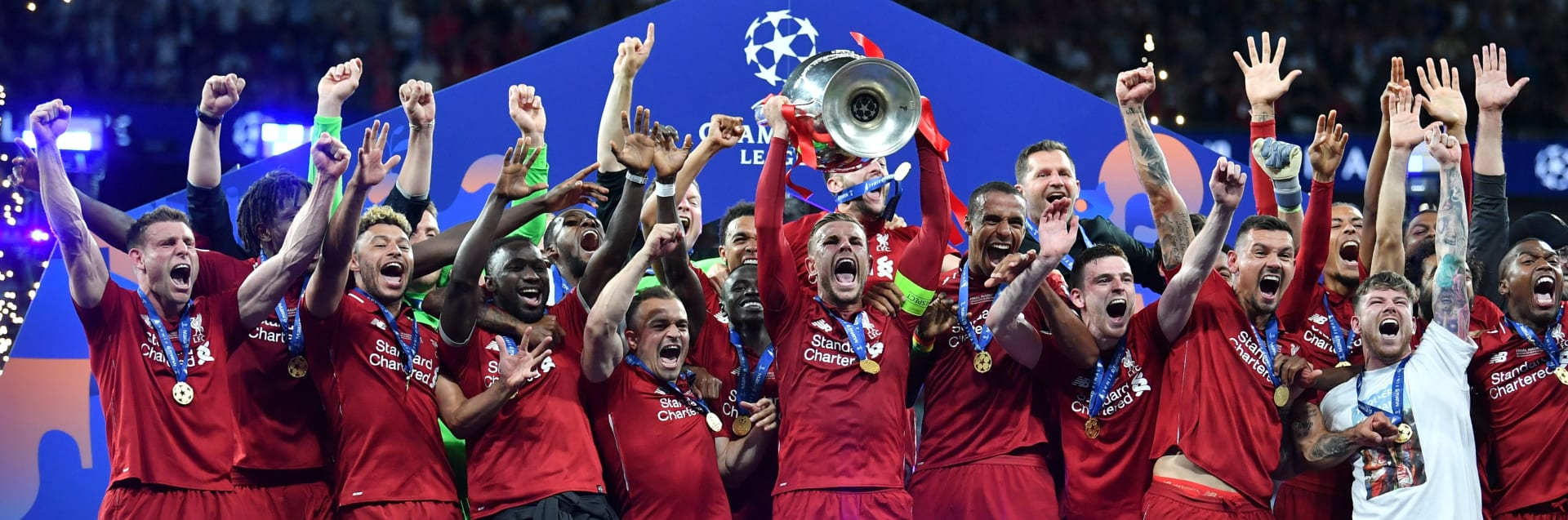 Liverpool's English midfielder Jordan Henderson raises the trophy after winning the UEFA Champions League final football match between Liverpool and Tottenham Hotspur at the Wanda Metropolitano Stadium in Madrid on June 1, 2019. (Photo by Ben STANSALL / AFP)        (Photo credit should read BEN STANSALL/AFP via Getty Images)