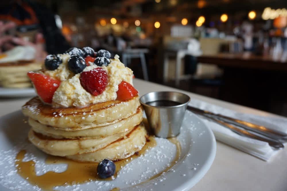 A stack of pancakes and berries at The Breakfast Club in Hackney Wick