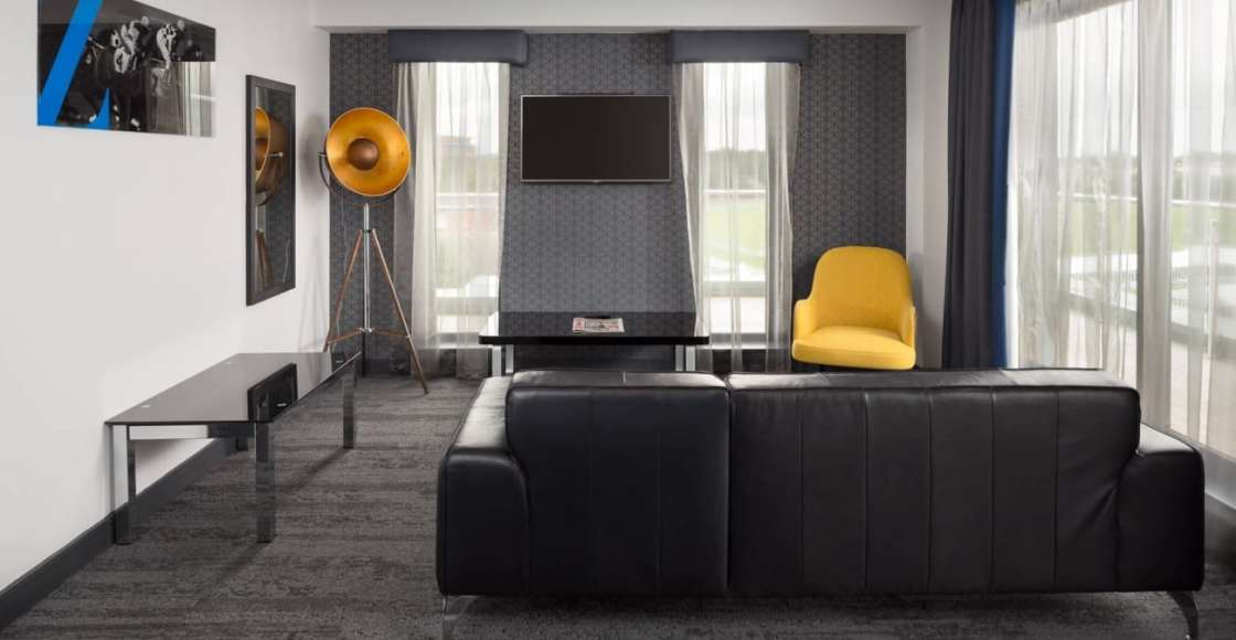 Stylish Ascot suite living room with seating and flat screen TV – Serviced Apartment Chester
