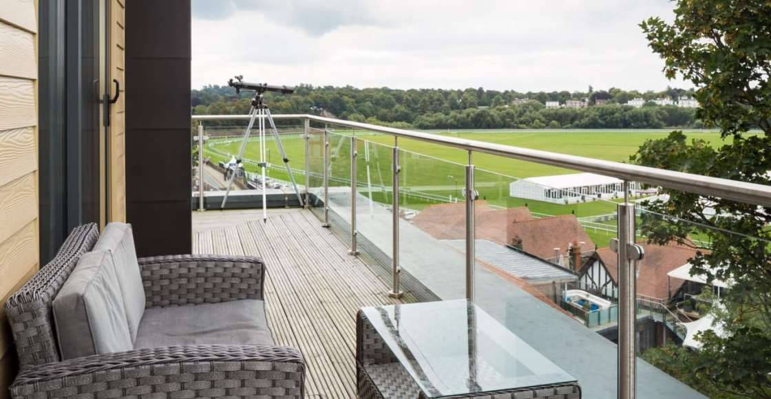 Large penthouse balcony with racecourse view and seating – Serviced Apartment Chester