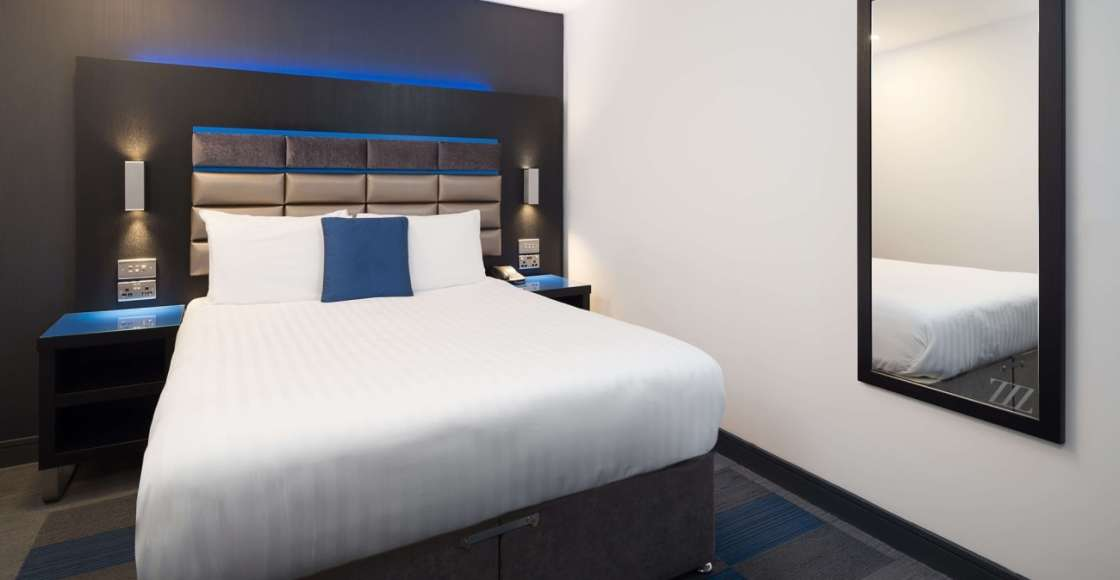 Ascot Suite bedroom with king size bed, bedside tables and power points.  – Serviced Apartment Chester