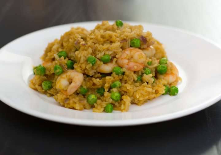 A plate of prawn stir-fried rice. Recipe created by Chris Hale for Roomzzz Aparthotels.
