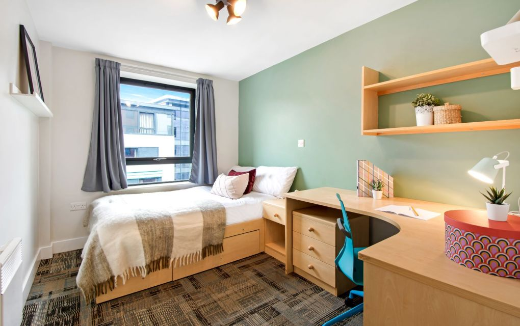 Standard student apartment in Leeds with double bed, desk and shelves. IconInc, Triangle
