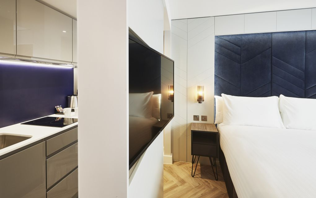 Smart studio student apartment in Newcastle with King Size bed and kitchen. IconInc @ Roomzzz Newcastle