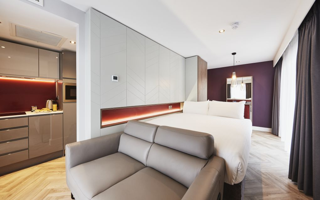 Neo Studio Student Apartment in Newcastle. King Size bed, Sofa and Kitchen. IconInc @ Roomzzz Newcastle