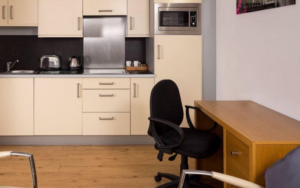 Smart Studio Student Apartment in Leeds.  kitchen and desk. IconInc @ Roomzzz Leeds City West