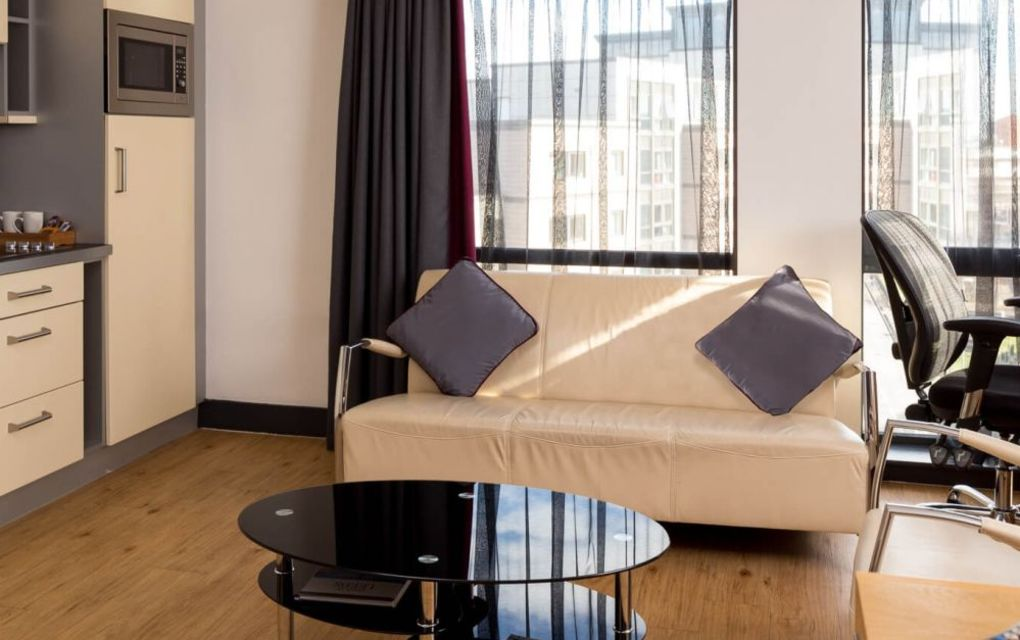 Grande Studio Student Apartment in Leeds. Kitchen/Lounge with sofa and desk. IconInc @ Roomzzz Leeds City West
