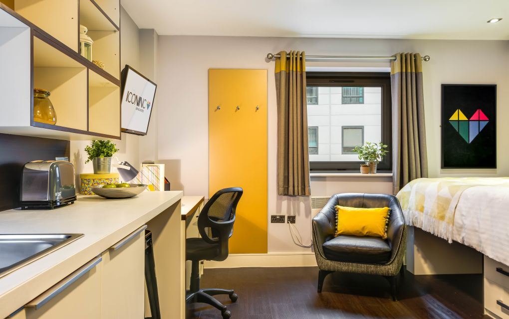 Smart Studio Apartment in Leeds with raised bed, Desk, Kitchen and Chair. IconInc, The Edge