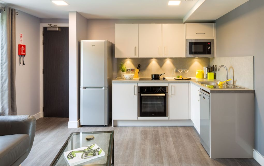 Grande Student Apartment in Leeds with spacious kitchen, Sofa and Coffee Table at IconInc, The Glassworks