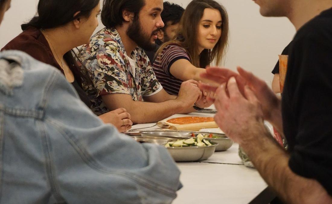 Students making pizzas with MasterChef 2016 quarterfinalist, Chris Hale