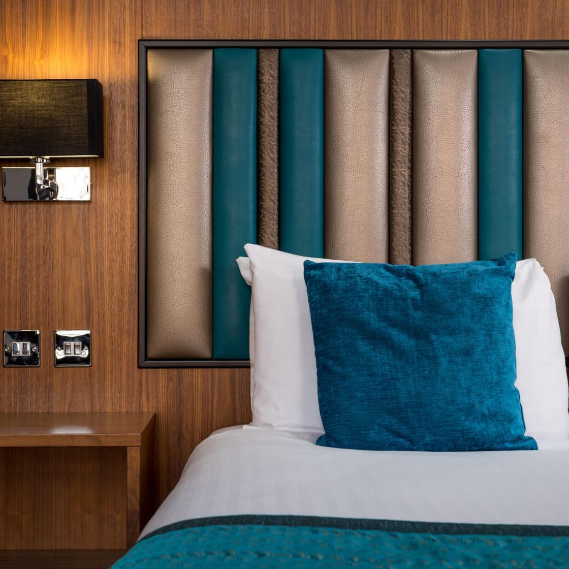 King Size Bed with bedside power points. IconInc @ Roomzzz. Student Apartments in Manchester
