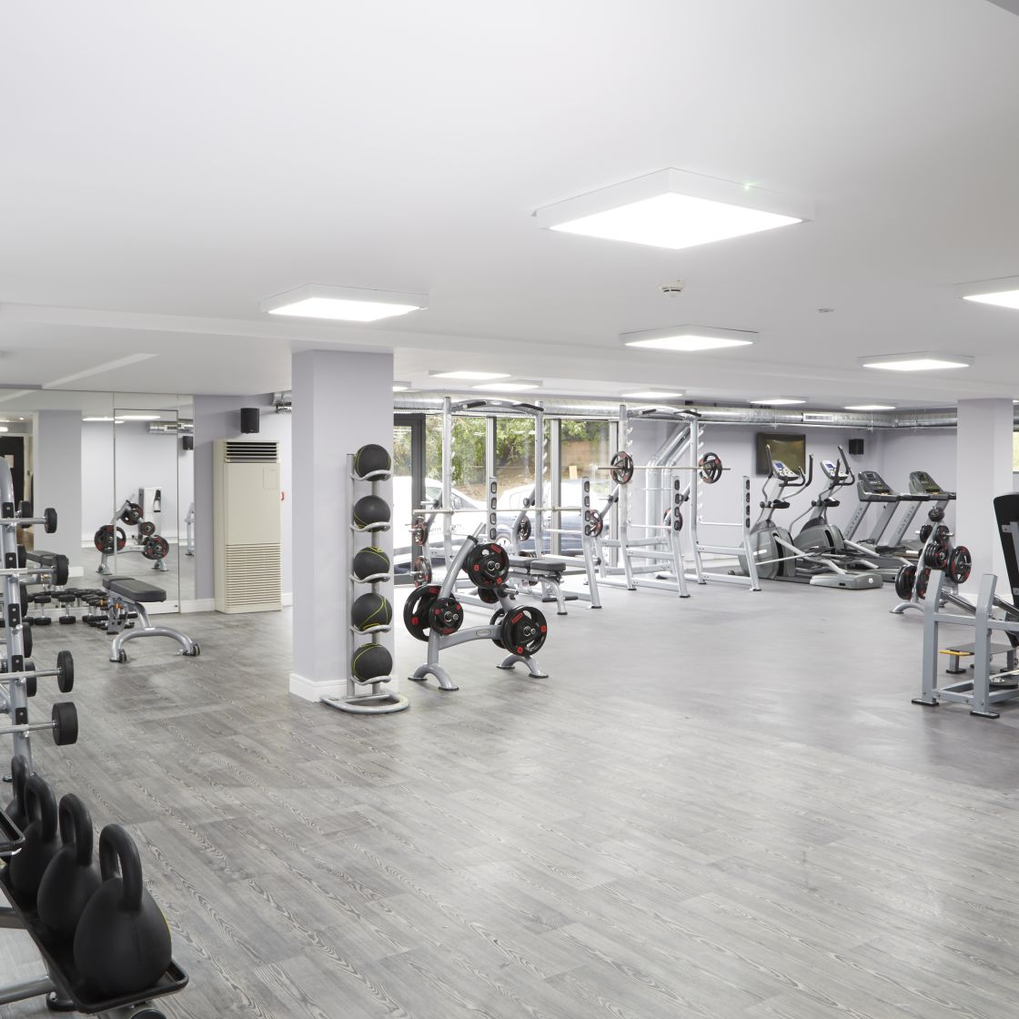 Large gym with cardio and strength equipment at IconInc, The Edge. Student Accommodation in Leeds