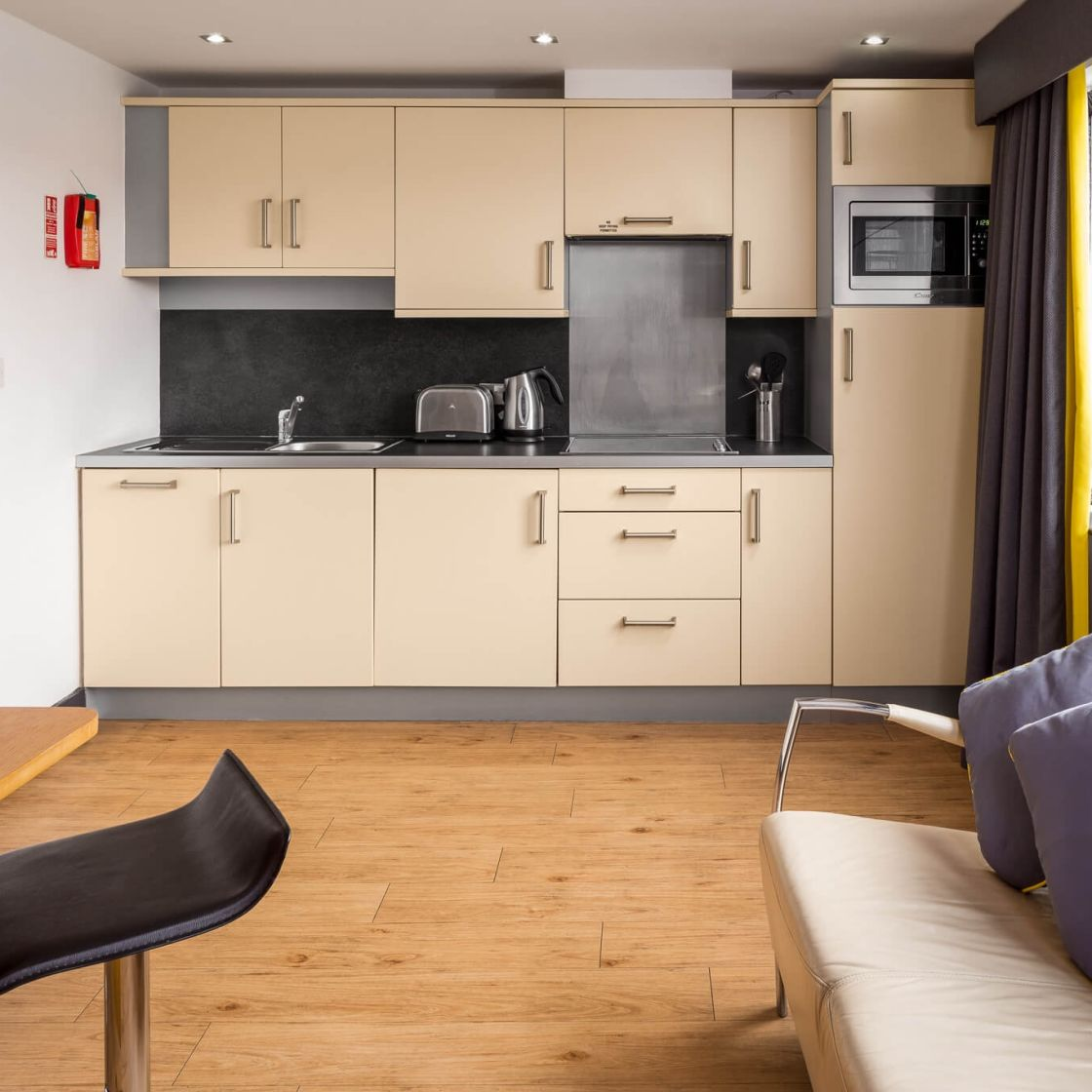 Grande Studio Student Apartment in Leeds. Kitchen and living area. IconInc @ Roomzzz Leeds City West