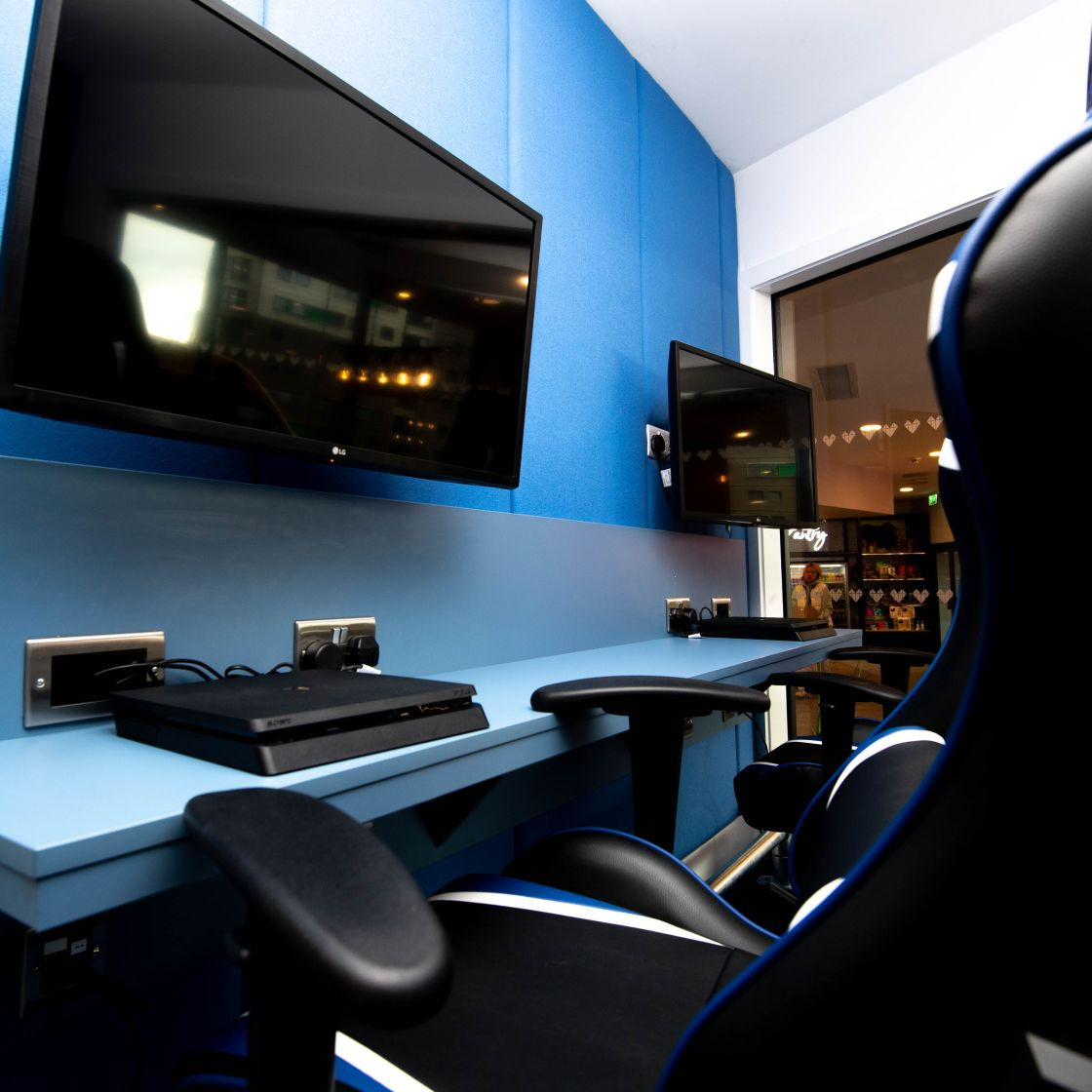 Gaming room with PlayStation consoles. IconInc, The Edge. Student Accommodation in Leeds