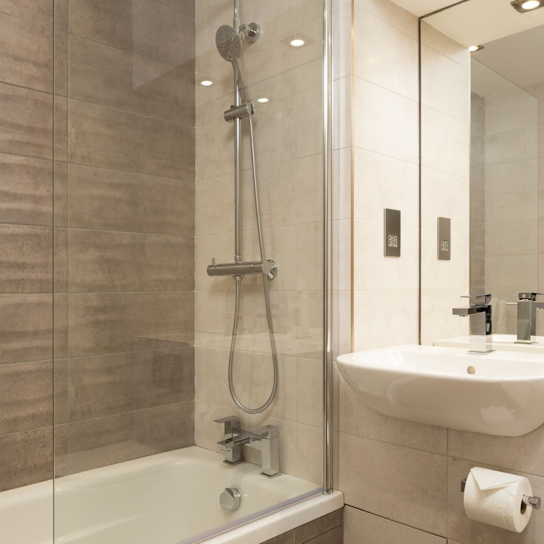 Neo Studio Student Apartment in London. En-suite bathroom with rain shower. IconInc @ Roomzzz