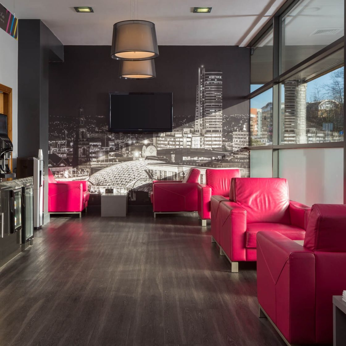 Reception lounge with seating at IconInc @ Roomzzz Leeds City West. Student Accommodation in Leeds