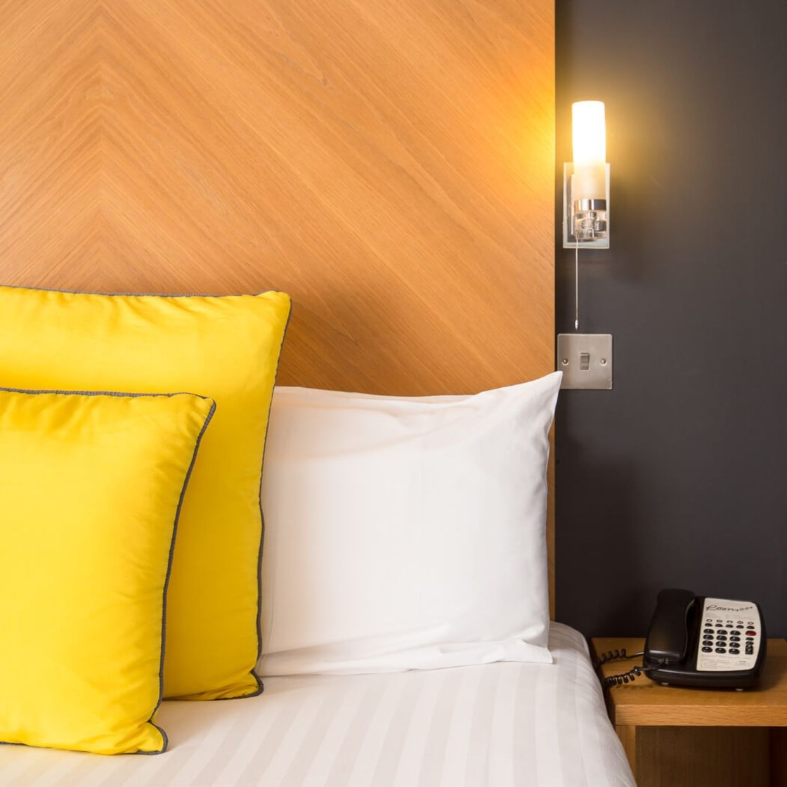 Smart Studio Student Apartment in Leeds. Bedside light and phone. IconInc @ Roomzzz Leeds City West