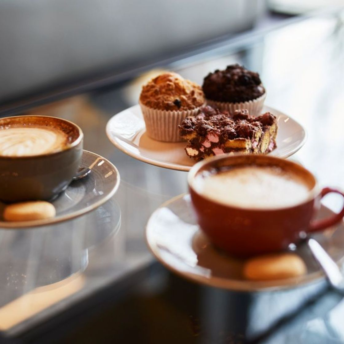 Fresh coffee with biscuits and freshly baked muffins and rocky road. IconInc @ Roomzzz