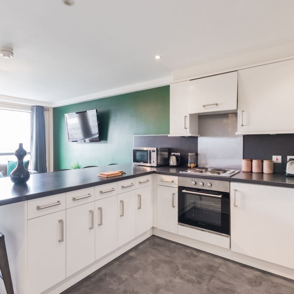 Large shared kitchen lounge with oven, microwave and TV. IconInc, Triangle. Student Accommodation in Leeds