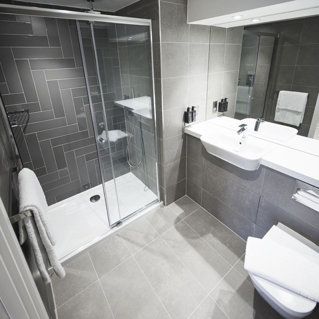 En-suite bathroom with rainfall shower. IconInc @ Roomzzz. Student Apartments in York