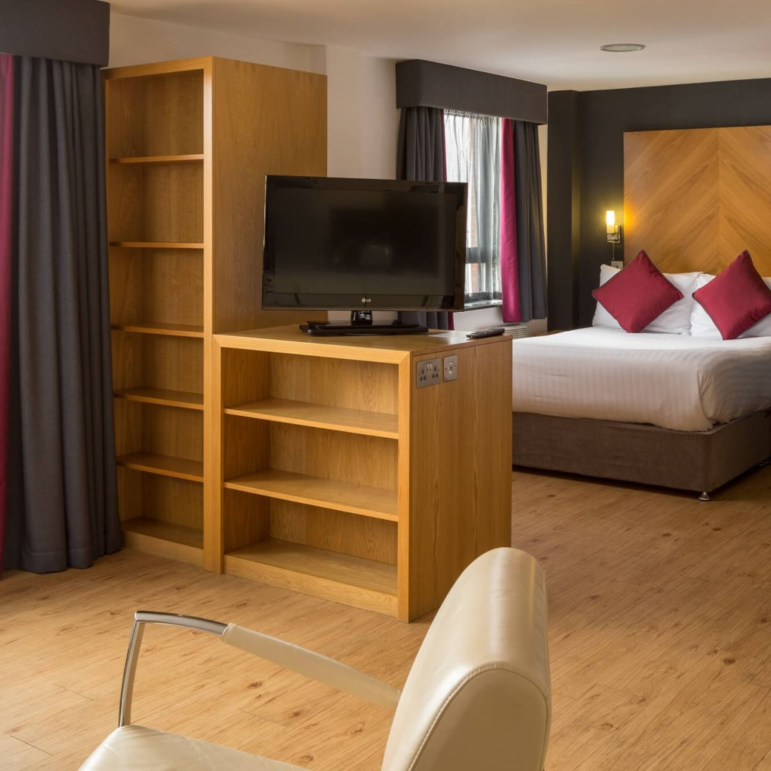 Grande studio student apartment in Leeds. King-size bed and TV. IconInc @ Roomzzz Leeds City West