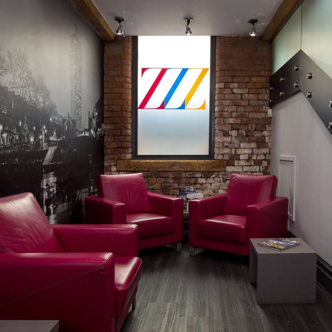 IconInc @ Roomzzz Manchester City Reception Lounge with Leather Armchairs. Student Accommodation in Manchester