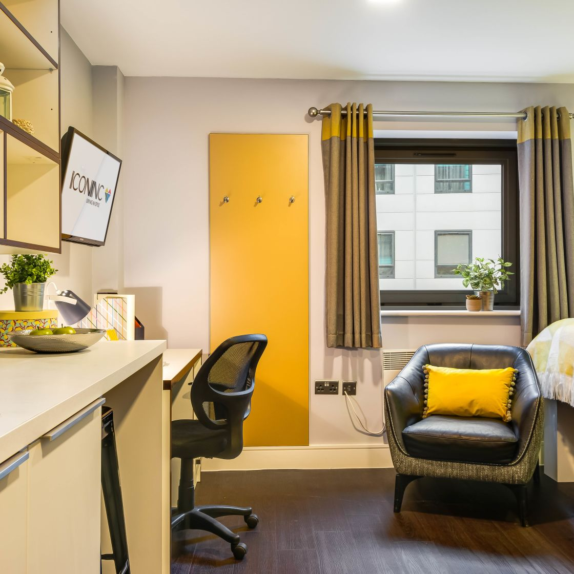 Smart Student Apartment in Leeds with raised bed, desk, tv and chair at IconInc, The Edge.